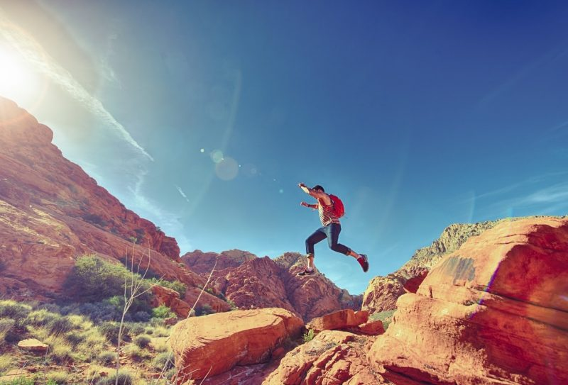 man-person-jumping-desert-min